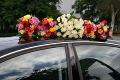 Bouquets on car. Five wedding bouquets on top of a black car Stock Images