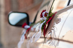 Bouquets on cars doors. Bouquets on cars side doors. Focus on closest bouquet Stock Images