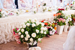 Bouquets of different flowers at wedding reception. Royalty Free Stock Photo