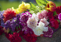 Bouquets of flowers at the monument. Bouquets of different colors laying on the monument Stock Images