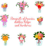 Bouquets of freesia, dahlias, tulips, herbera, lily in jars with bows Stock Photo