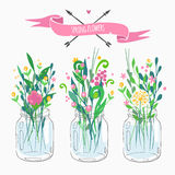 Bouquets in jars Royalty Free Stock Photography
