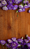 Bouquets of purple eustoma flowers on the wooden table Stock Photos