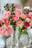 Bouquets of roses on a festive wedding table Stock Images
