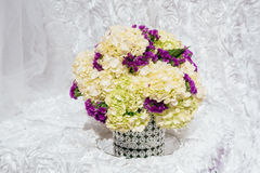 Bouquets of roses on a festive wedding table in the restaurant. Stock Photos