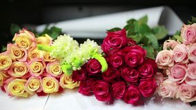 Bouquets of roses lay on the counter in the store. HD stock video footage