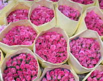 Bouquets roses for sale at a florist's shop with  paper Royalty Free Stock Images