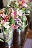 Bouquets in silver vases Stock Images