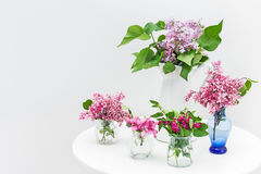 Bouquets of spring flowers on a white table Royalty Free Stock Photography