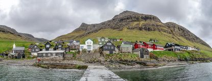 Bour, Faroe Islands. Typical nordic village overlooking a fjord surrounded by green mountains