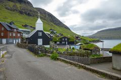 Bour village. Typical grass-roof houses and green mountains. Vagar island, Faroe Islands. Denmark. Europe