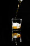 Bourbon. Glass of bourbon being poured stock photos