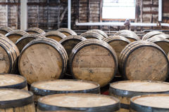 Bourbon Barrel Storage Room. With barrels standing and rolling Stock Image
