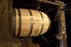 Bourbon barrels aging in a distillery warehouse Royalty Free Stock Photo