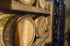 Bourbon barrels on rack in warehouse Stock Images