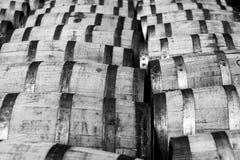 Bourbon barrels. Rows of oak bourbon barrels at a distillery warehouse Stock Photo