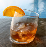Bourbon coctail. Glass with the bourbon, ice and slice of orange Royalty Free Stock Photos