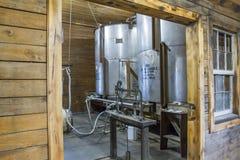 Bourbon distillery barrel filling room. Barrel filling operations at craft bourbon distillery Royalty Free Stock Photo