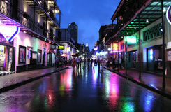 Bourbon Night. NEW ORLEANS LOUISIANA - JUNE 5, 2005:  Bourbon Street reflects on a rainy night Royalty Free Stock Photo