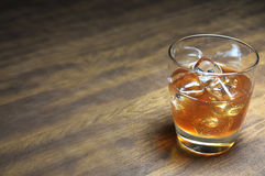 Bourbon on the Rocks. On wooden table with copy space Royalty Free Stock Photography
