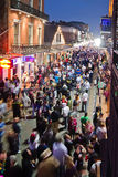 Bourbon Street at dusk. View of Bourbon Street from balcony at dusk during Mardi Gras