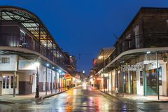 Bourbon Street in French Quarter, New Orleans. Historic Buildings on Bourbon Street at St Peter Street in French Quarter at night in New Orleans, Louisiana, USA stock images