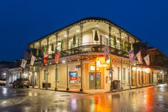 Bourbon Street in French Quarter, New Orleans. Historic Buildings at the corner of Bourbon Street and Orleans Street in French Quarter at night in New Orleans Stock Photos