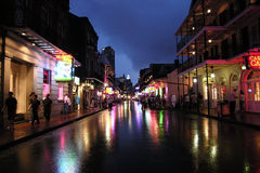 Bourbon Street Night. NEW ORLEANS LOUISIANA - JUNE 5, 2005:  Bourbon Street partys on a rainy night Stock Photos