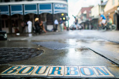 Bourbon Street Sidewalk. A Bourbon Street tiled sign is embedded in the sidewalk on Bourbon St. in New Orleans' oldest neighborhood, the French Quarter Royalty Free Stock Photos