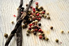 Bourbon vanilla bean variety with seed peppercorns Stock Photography