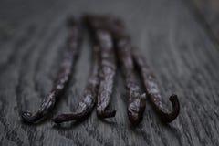 Bourbon vanilla pod on oak table Stock Photography