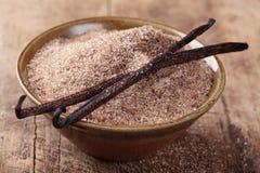 Bourbon vanilla sugar and Vanilla beans. In bowl Stock Photo