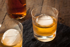 Bourbon Whiskey with a Sphere Ice Cube Stock Images