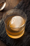 Bourbon Whiskey with a Sphere Ice Cube Stock Photo