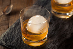 Bourbon Whiskey with a Sphere Ice Cube Stock Image