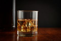 A glass of whiskey with ice stock photo