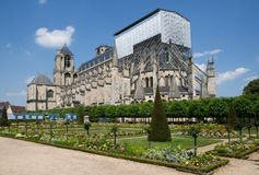 Bourges, France. The garden and the Cathedral in reconstruction  Bourges,France Royalty Free Stock Photos