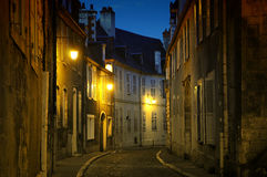 Bourges. Illuminated cobbled street in Bourges, France stock photos