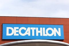 Decathlon sign on a wall. Bourgoin, France - June 26, 2017: Decathlon sign on a wall. Decathlon is a french company and one of the world`s largest sporting goods royalty free stock photo