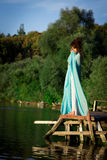 Fairy, princess, goddess of wood in green dress stand outdoors Royalty Free Stock Image