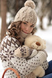 Very cute,lovely,beautiful,attractive,gorgeous girl with curly,wavy hair hug a teddy bear.Cute little girl with toy,white,big bear Stock Images