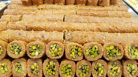 Bourma with pistachios a typical Lebanese sweets. Lebanese cuisine. Sidon, Lebanon royalty free stock image