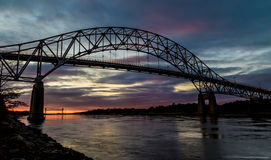 Bourne Bridge in Cape Cod at Sunset. With Train Bridge in the Background Royalty Free Stock Photo