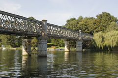 Bourne End Railway Bridge. View from the Berkshire bank of the River Thames of the Bourne End Railway Bridge carrying trains across to Buckinghamshire Stock Photo
