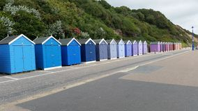 Bournemouth beach huts. Colourful beach huts on Bournemouth beach near pier Stock Images