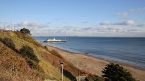 Bournemouth beach pier and coast Dorset England UK near to Poole known for beautiful sandy beaches. With blue sky stock video footage