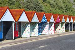 Bournemouth beach sheds near the beach. Variety of colorful rental beach sheds along a road on a sunny day. Bournemouth, England Royalty Free Stock Photography
