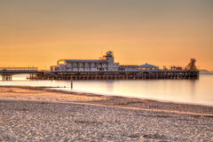 Bournemouth Pier Sunrise. Sunrise on Bournemouth Beach with the Pier in the background Stock Photo