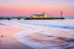Bournemouth pier sunset. Bournemouth pier at Sunset from beach Dorset England UK Europe Stock Photos