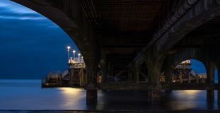 Bournemouth Pier, UK, photographed from underneath amongst the supports, in low light early in the morning. stock photo